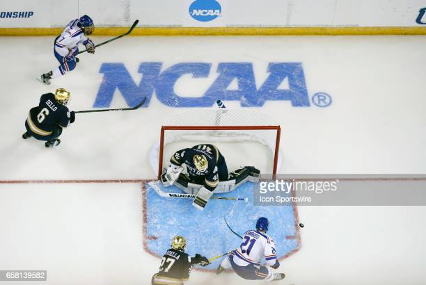 Notre Dame Fighting Irish defenseman Bobby Nardella breaks up UMass Lowell River Hawks left wing Jake Kamrass in front of Notre Dame Fighting Irish...