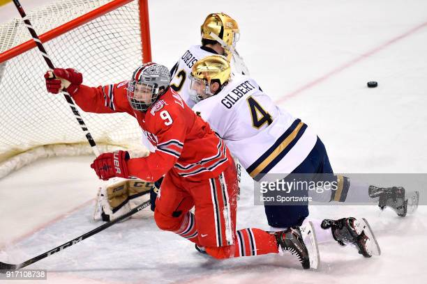 Notre Dame Fighting Irish defenseman Dennis Gilbert collides with Ohio State Buckeyes forward Tanner Laczynski near the goal during the game between...