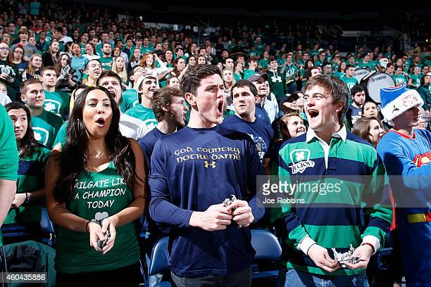 Notre Dame Fighting Irish fans cheer against the Florida State Seminoles during the game at Purcell Pavilion on December 13 2014 in South Bend...