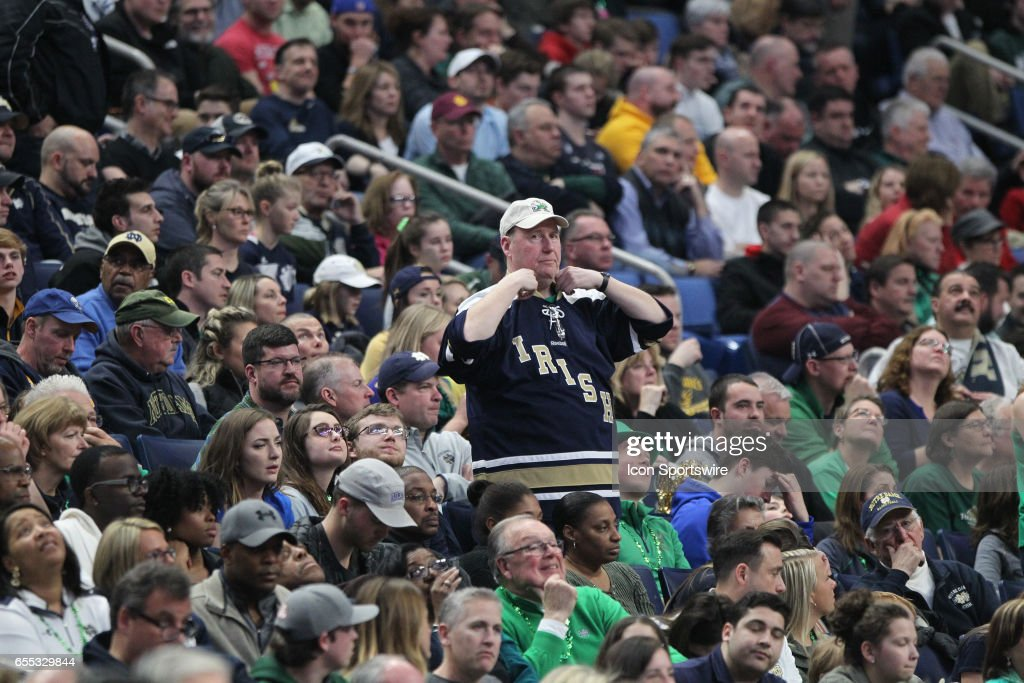 Notre Dame Fighting Irish fans cheer during the NCAA Division 1 Men's Basketball Championship game between Notre Dame Fighting Irish and West Virginia Mountaineers on March 18, 2017 at the Key Bank Center in Buffalo, NY.