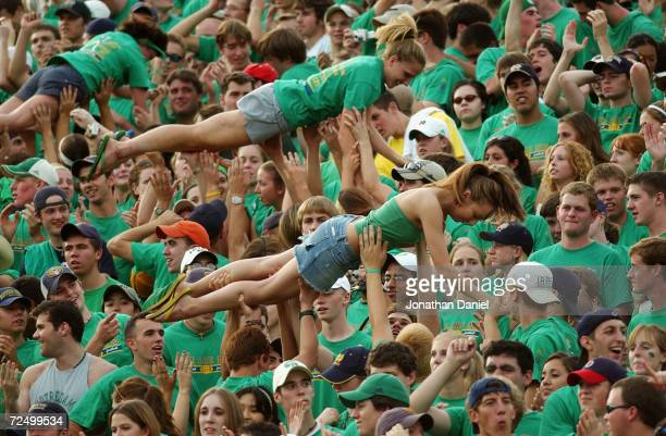 Notre Dame Fighting Irish fans crowd surf in the student section during a game with the Michigan Wolverines on September 11, 2004 at Notre Dame...