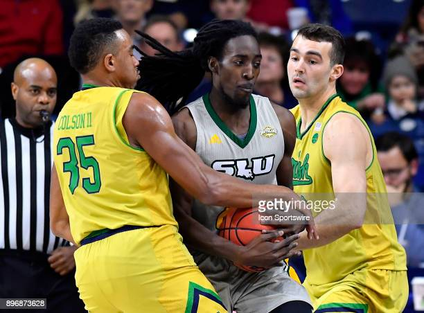 Notre Dame Fighting Irish forward Bonzie Colson and Notre Dame Fighting Irish forward John Mooney trap Southeastern Louisiana Lions guard Keith...