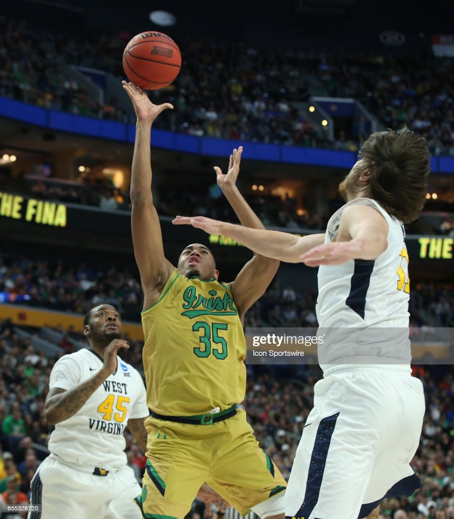 Notre Dame Fighting Irish forward Bonzie Colson (35) shoots over West Virginia Mountaineers guard Tarik Phillip (12) during the NCAA Division 1 Men's Basketball Championship game between Notre Dame Fighting Irish and West Virginia Mountaineers on March 18, 2017 at the Key Bank Center in Buffalo, NY.
