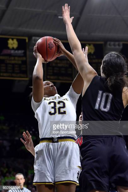 Notre Dame Fighting Irish forward Danielle Patterson shoots over Cal State Northridge Matadors forward Tessa Boagni during the first round of the...