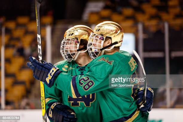 Notre Dame Fighting Irish forward Dylan Malmquist celebrates an improbable goal with Notre Dame Fighting Irish forward Jack Jenkins after an attempt...