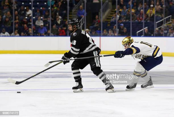 Notre Dame Fighting Irish forward Jake Evans pursues Providence Friars defenseman Jacob Bryson during a NCAA hockey game between Providence Friars...