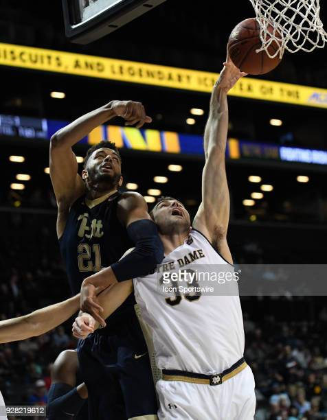 Notre Dame Fighting Irish forward John Mooney battles Pittsburgh Panthers forward Terrell Brown for a rebound during the ACC men's tournament game...