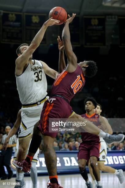 Notre Dame Fighting Irish forward John Mooney blocks the shot of Virginia Tech Hokies guard Justin Bibbs during the game between the Virginia Tech...