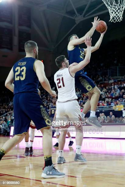 Notre Dame Fighting Irish forward John Mooney drives on Boston College forward Nik Popovic during an ACC game between the Boston College Eagles and...