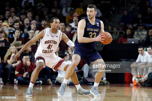 Notre Dame Fighting Irish forward John Mooney looks inside watched by Boston College guard Jerome Robinson during an ACC game between the Boston...