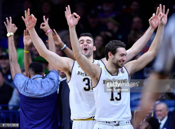 Notre Dame Fighting Irish forward John Mooney Notre Dame Fighting Irish guard Nikola Djogo and teammates react to the three pointer made by Notre...