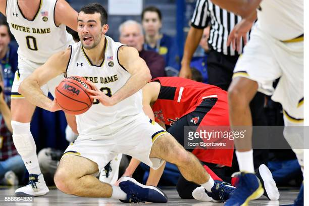 Notre Dame Fighting Irish forward John Mooney passes the ball during the game between the Notre Dame Fighting Irish and the Ball State Cardinals on...