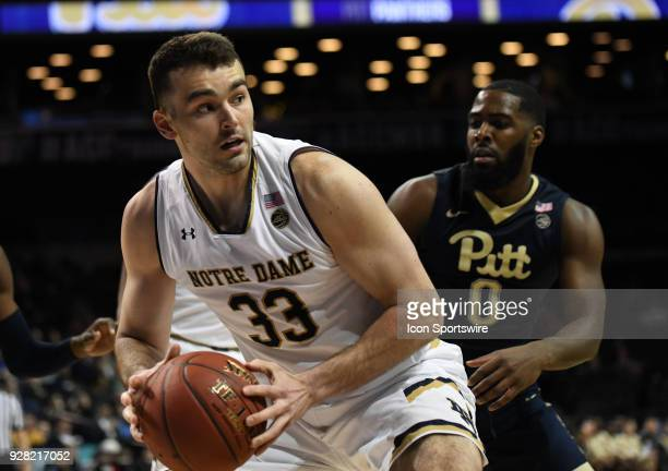 Notre Dame Fighting Irish forward John Mooney posts near the basket on Pittsburgh Panthers guard Jared WilsonFrame during the ACC men's tournament...