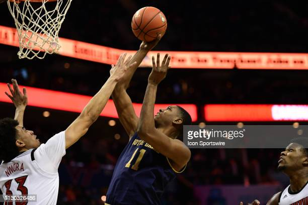 Notre Dame Fighting Irish forward Juwan Durham goes up for inside shot over Louisville Cardinals forward Jordan Nwora during the ACC basketball...