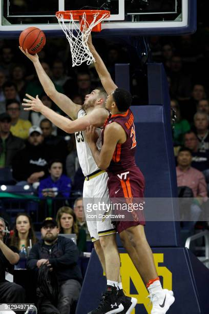 Notre Dame Fighting Irish forward Martinas Geben with the reverse lay up in front of Virginia Tech Hokies forward Kerry Blackshear Jr during the game...