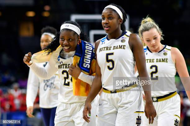 Notre Dame Fighting Irish guard Arike Ogunbowale and Notre Dame Fighting Irish guard Jackie Young are seen leaving the court after defeating the Cal...