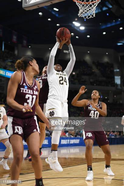 Notre Dame Fighting Irish guard Arike Ogunbowale battles with Texas AM Aggies guard Chennedy Carter and Texas AM Aggies center Ciera Johnson in game...