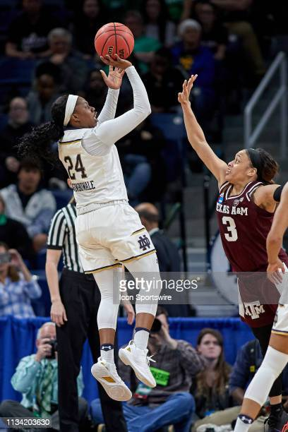 Notre Dame Fighting Irish guard Arike Ogunbowale battles with Texas AM Aggies guard Chennedy Carter to shoot the ball in game action during the...
