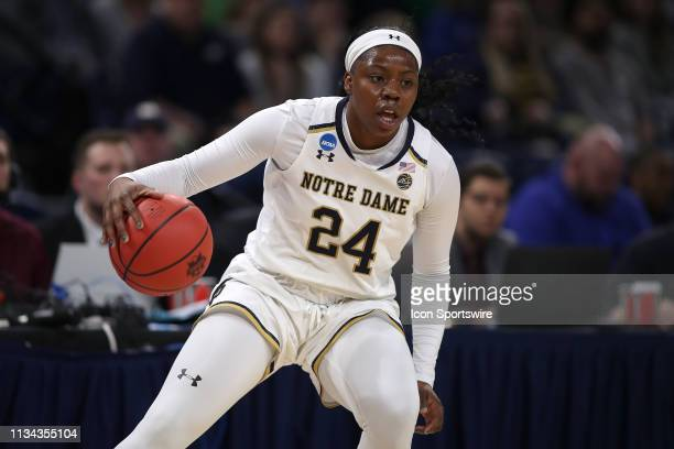 Notre Dame Fighting Irish guard Arike Ogunbowale dribbles the ball in game action during the Women's NCAA Division I Championship Quarterfinals game...