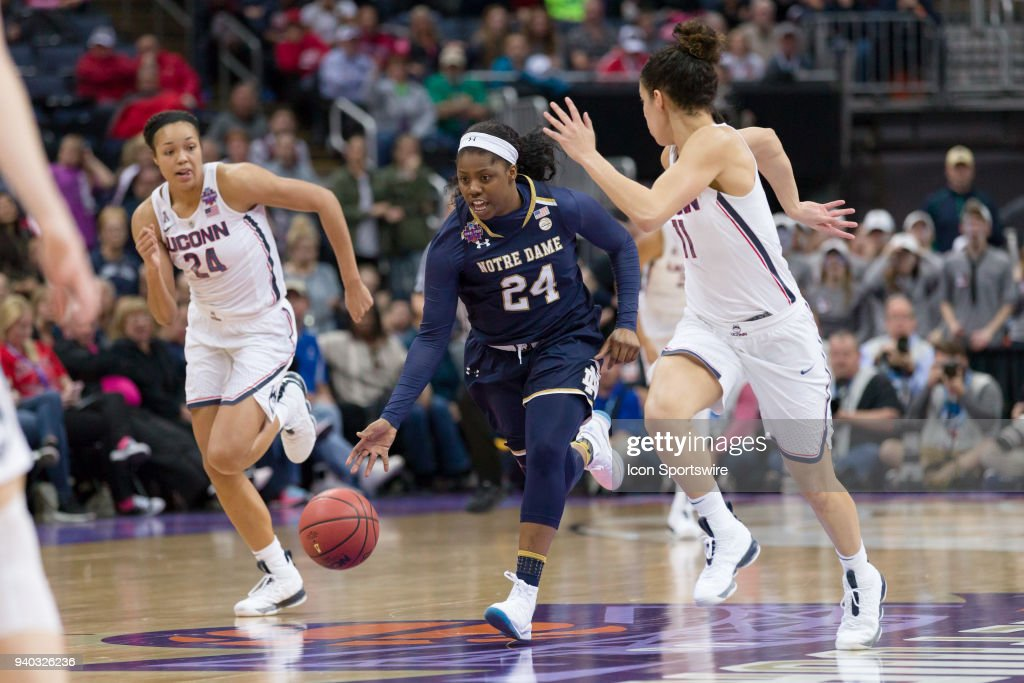 Notre Dame Fighting Irish guard Arike Ogunbowale (24) drives past Connecticut Huskies guard Kia Nurse (11) in the Division I Women's Championship semifinal game between the Notre Dame Fighting Irish and the UConn Huskies on March 30, 2018 at Nationwide Arena in Columbus, OH. Notre Dame won 91-89 in overtime.