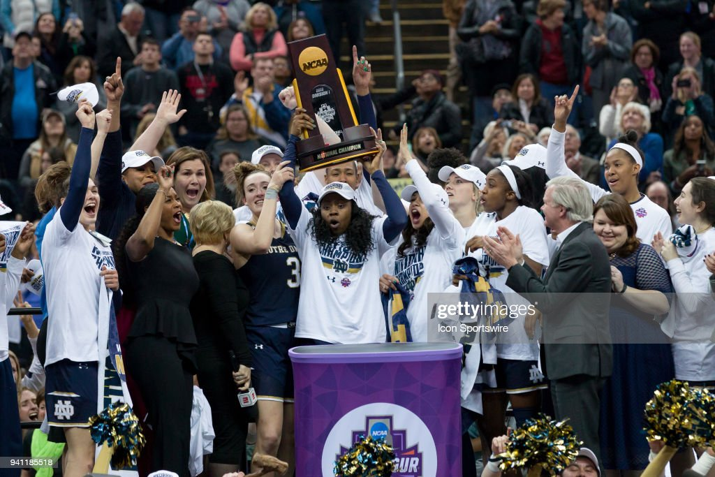 Notre Dame Fighting Irish guard Arike Ogunbowale (24) hoists the national championship trophy after winning the National Championship game between the Mississippi State Lady Bulldogs and the Notre Dame Fighting Irish on April 1, 2018 at Nationwide Arena. Notre Dame won 61-58.