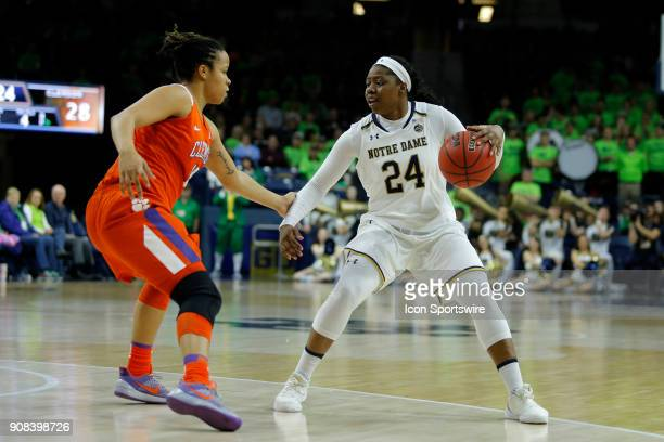 Notre Dame Fighting Irish guard Arike Ogunbowale looks to get around Clemson Tigers guard Jaia Alexander during the game between the Clemson Tigers...