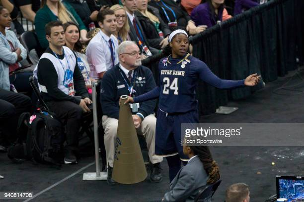 Notre Dame Fighting Irish guard Arike Ogunbowale picks up a megaphone on the way past the basket then argues a call in the National Championship game...