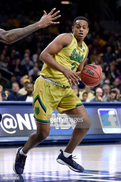 Notre Dame Fighting Irish guard DJ Harvey dribbles the basketball during the college basketball game between the Louisville Cardinals and the Notre...