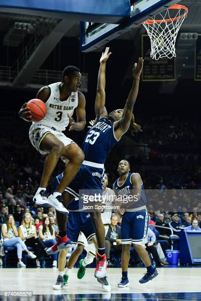 Notre Dame Fighting Irish guard DJ Harvey passes the ball against Mount St Mary's Mountaineers guard Greg Alexander during the game between the Mount...