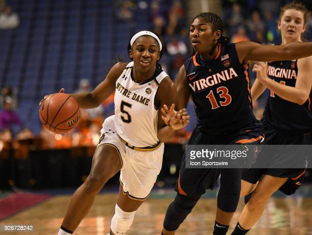 Notre Dame Fighting Irish guard Jackie Young drives past Virginia Cavaliers guard Jocelyn Willoughby during the ACC women's tournament game between...
