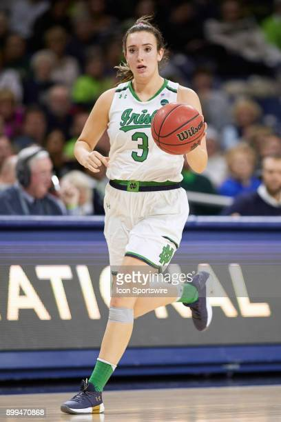 Notre Dame Fighting Irish guard Marina Mabrey dribbles the basketball during the women's college basketball game between the Syracuse Orange and the...