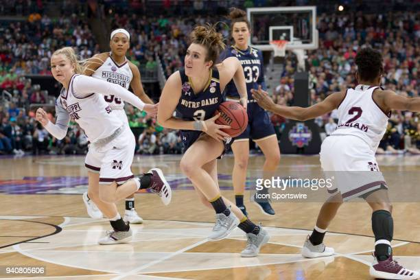Notre Dame Fighting Irish guard Marina Mabrey drives through heavy traffic in the National Championship game between the Mississippi State Lady...