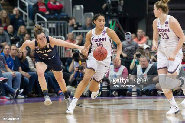 Notre Dame Fighting Irish guard Marina Mabrey pokes the ball loose from Connecticut Huskies forward Gabby Williams and is called for a foul in the...