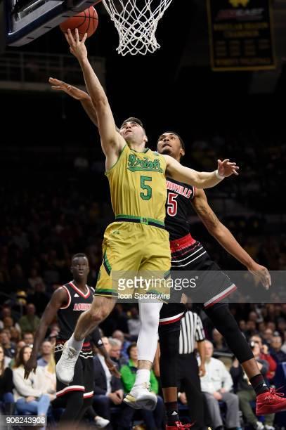 Notre Dame Fighting Irish guard Matt Farrell battles with Louisville Cardinals forward Malik Williams for a layup during the college basketball game...