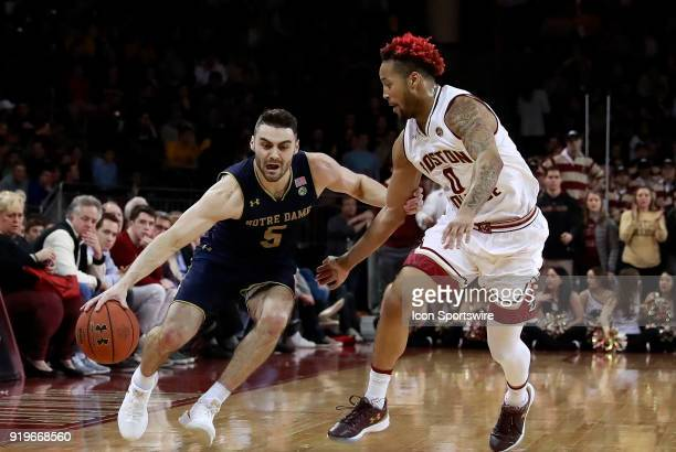 Notre Dame Fighting Irish guard Matt Farrell drives on Boston College guard Ky Bowman during an ACC game between the Boston College Eagles and the...