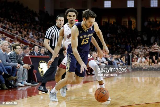 Notre Dame Fighting Irish guard Nikola Djogo slips past Boston College guard Jerome Robinson during an ACC game between the Boston College Eagles and...