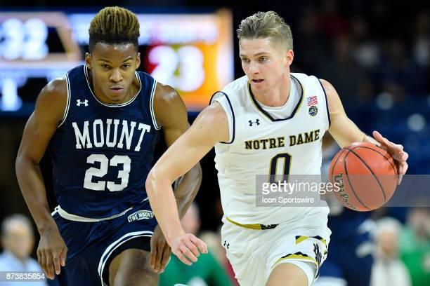 Notre Dame Fighting Irish guard Rex Pflueger brings up the ball against Mount St Mary's Mountaineers guard Greg Alexander during the game between the...