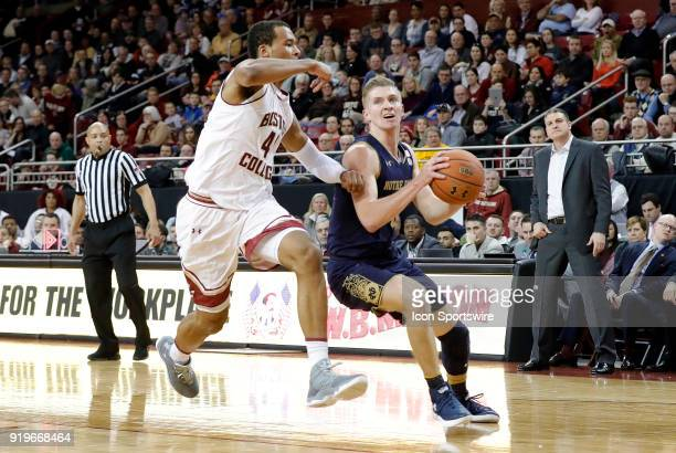 Notre Dame Fighting Irish guard Rex Pflueger drives past Boston College forward Steffon Mitchell during an ACC game between the Boston College Eagles...