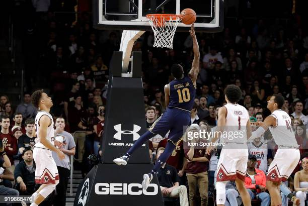 Notre Dame Fighting Irish guard Temple 'TJ' Gibbs Jr beats three Eagles for an artistic lay up during an ACC game between the Boston College Eagles...