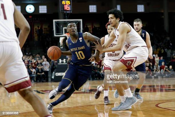 Notre Dame Fighting Irish guard Temple 'TJ' Gibbs Jr drives past Boston College center Johncarlos Reyes during an ACC game between the Boston College...