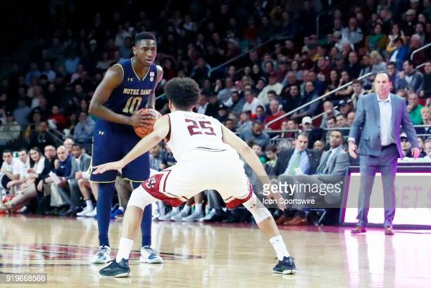 Notre Dame Fighting Irish guard Temple TJ Gibbs Jr holds the ball watched by Boston College guard Jordan Chatman during an ACC game between the...