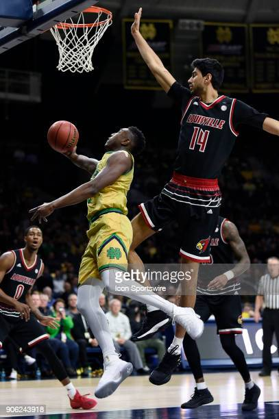 Notre Dame Fighting Irish guard TJ Gibbs battles with Louisville Cardinals forward Anas Mahmoud for a layup during the college basketball game...