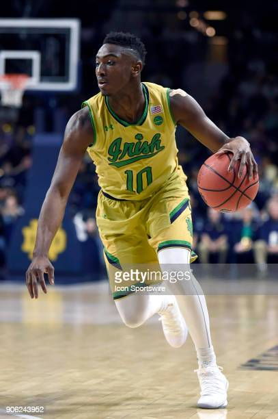 Notre Dame Fighting Irish guard TJ Gibbs dribbles the basketball during the college basketball game between the Louisville Cardinals and the Notre...
