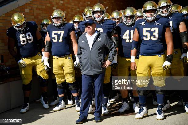 Notre Dame Fighting Irish head coach Brian Kelly stands in the tunnel in front of his team before the game against the Pittsburgh Panthers at Notre...
