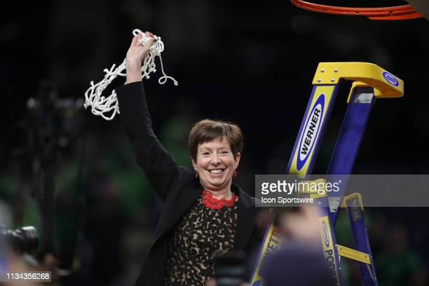 Notre Dame Fighting Irish head coach Muffet McGraw celebrates with fans and teammates after cutting down the net during the net cutting ceremony...