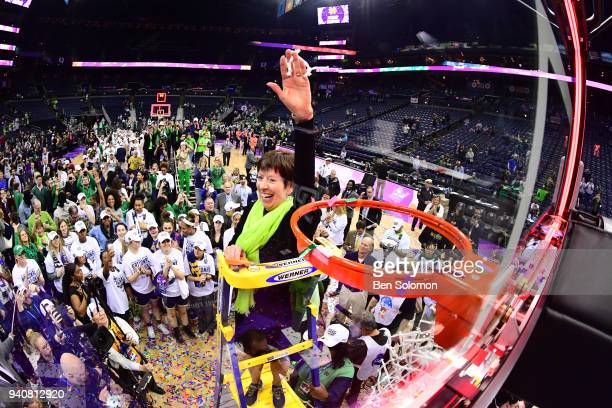 Notre Dame Fighting Irish head coach Muffet McGraw waves to the crowd after cutting a piece of the net to celebrate beating Mississippi in the...