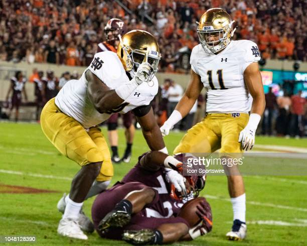 Notre Dame Fighting Irish Linebacker Te'von Coney reacts to tackling Virginia Tech Hokies Running Back Steven Peoples along with Notre Dame Fighting...