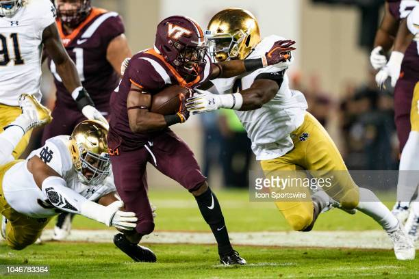 Notre Dame Fighting Irish Linebacker Te'von Coney tackles Virginia Tech Hokies Running Back Deshawn McClease carrying the ball during the first...