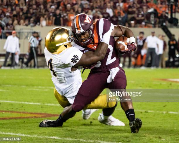 Notre Dame Fighting Irish Linebacker Te'von Coney tackles Virginia Tech Hokies Running Back Steven Peoples during the first quarter of the Notre Dame...