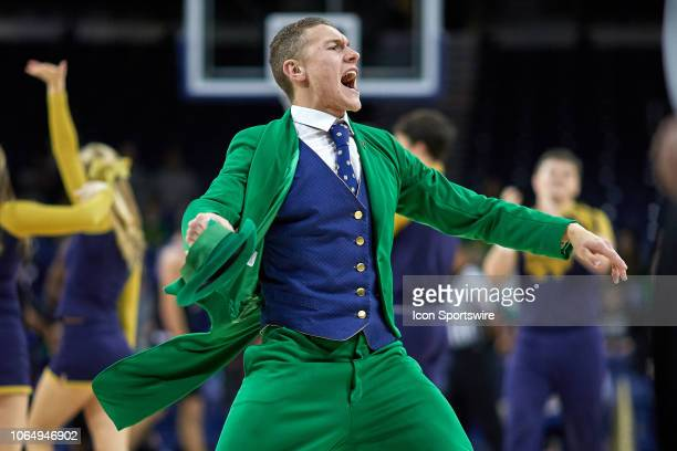 Notre Dame Fighting Irish mascot the leprechaun celebrates with the Notre Dame Fighting Irish cheerleaders in action during a college basketball game...